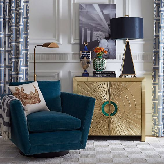 A dazzling, luxurious cabinet with a brass finish and natural malachite inlaid handles