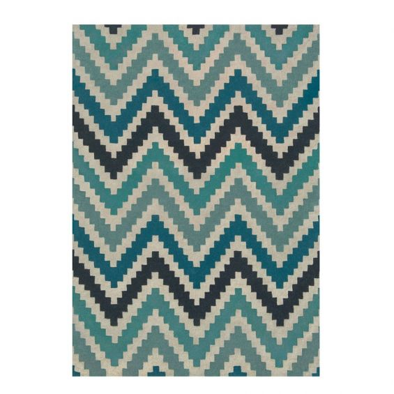 Hand-tufted wool rug with chevron pattern in teal