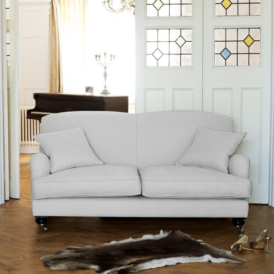 Elegant, British style sofa with firm back and cushioned seating