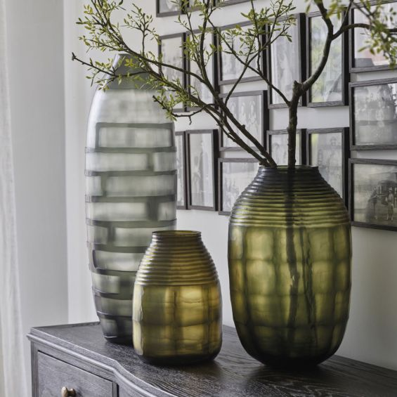 A stylish glass vase with a tinted finish by Willow's Collection