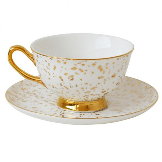 Splattered white and gold teacup and saucer