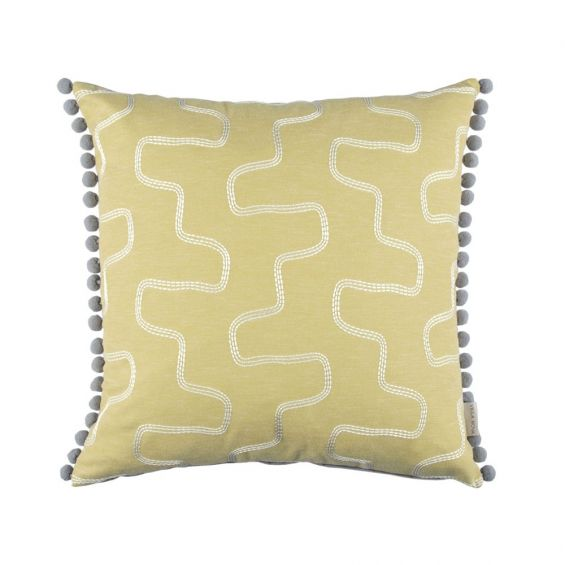 Abstract silver embroidered design on yellow cushion