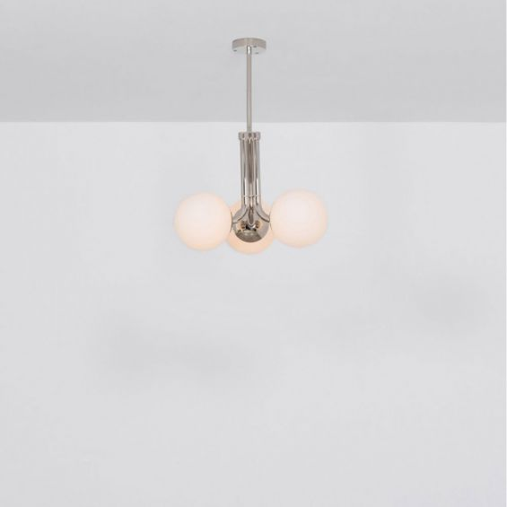 A chic, early century inspired LED pendant with translucent opal globes