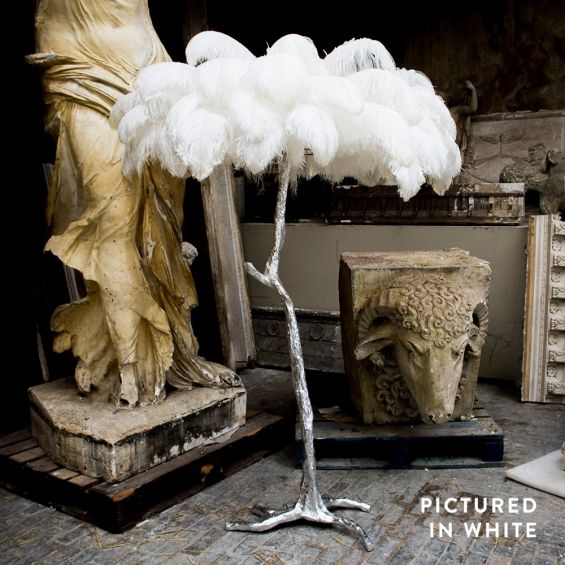 Modern, mini ostrich feather lamp with silver base