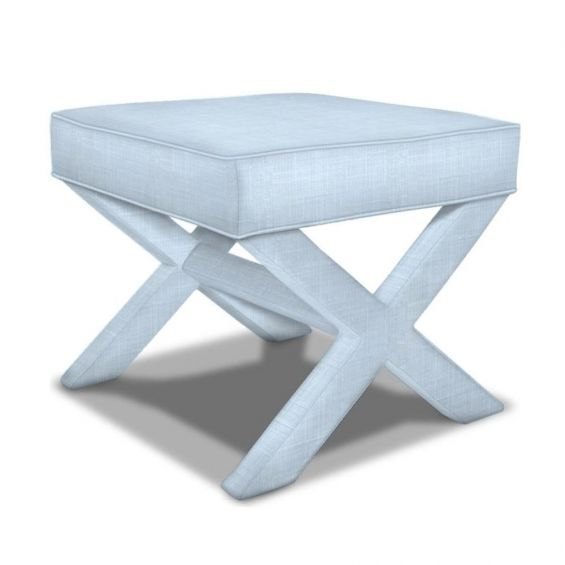 A luxurious bench with x-shaped legs with sky blue upholstery
