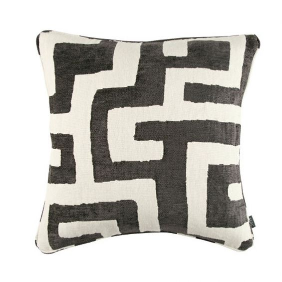 Monochromatic black and white cushion with an tribal inspired design