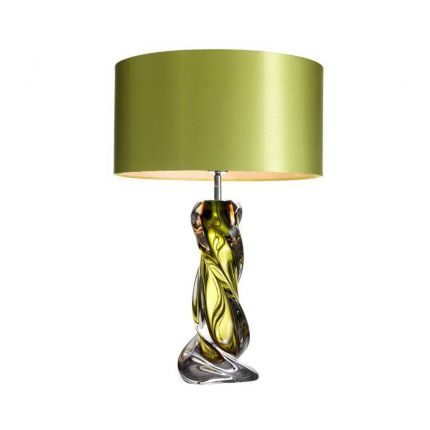 A luxurious hand blown glass lamp with a green tint and matching shade