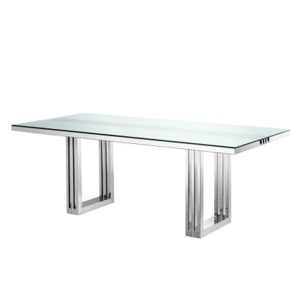 contemporary dining table with transparent surface and stainless steel frame