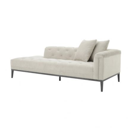 deep-buttoned cream lounge sofa with black legs