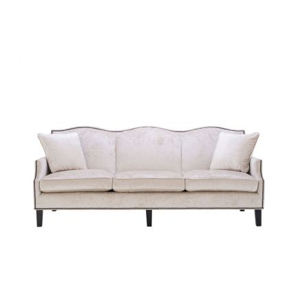 velvety off-white 3 seater sofa with bronze accents and black tapered legs