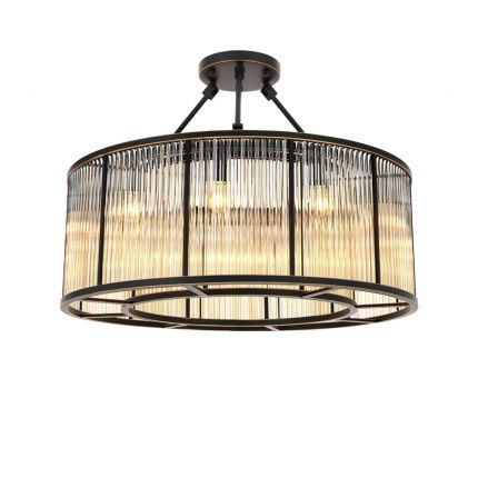 A luxurious bronze chandelier with clear, ribbed glass