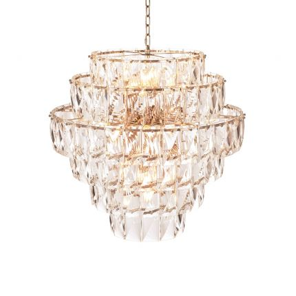 A breathtakingly glamorous chandelier by Eichholtz featuring a sparking crystal glass design that will enrich your interior with everlasting luxury