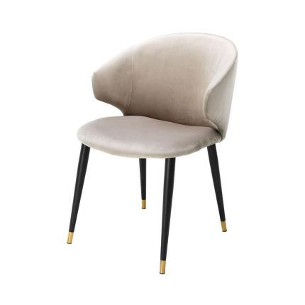 Luxury beige velvet dining chair with black and gold tapered legs