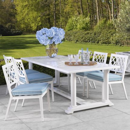 white outdoor dining chair with blue and white cushion