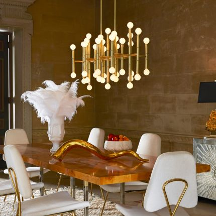 An elegant chandelier with brass bamboo stalks and globe bulbs