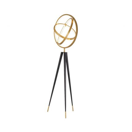 brass galaxy halo-inspired floor lamp with black tapered legs and brass caps.