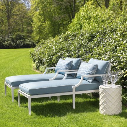 modern, outdoor chaise longue in white with blue cushions and white piping
