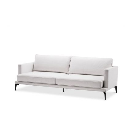 A chic contemporary sofa with white upholstery and contrasting black feet