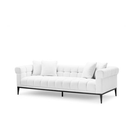 A fabulously sumptuous upholstered sofa with deep-buttoning