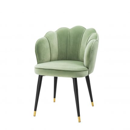 a gorgeous pale green dining chair with gold-capped tapered legs