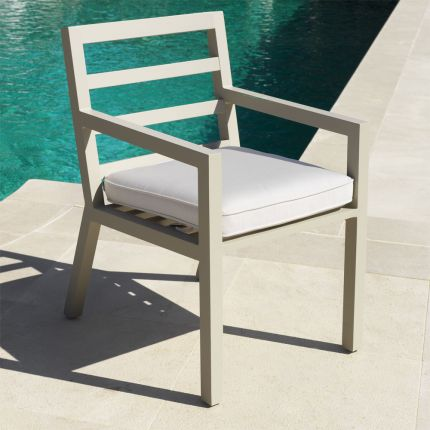 Contemporary sand-toned outdoor dining chair with neutral seat cushion by Eichholtz