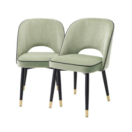 Pistachio green velvet set of 2 dining chairs with faux leather piping an d gold caps on black frame