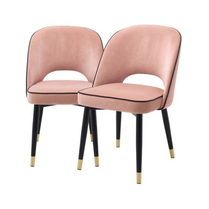Nude pink velvet set of 2 dining chairs with faux leather piping and gold caps on black legged frame
