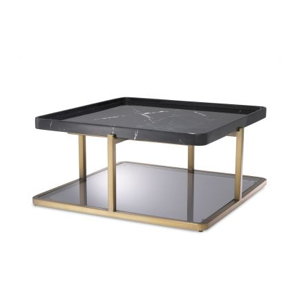 A stylish brushed brass, black marble and smoked glass coffee table