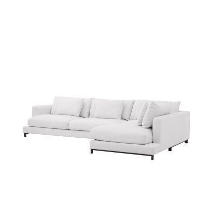 A luxurious white contemporary lounge sofa with scatter cushions