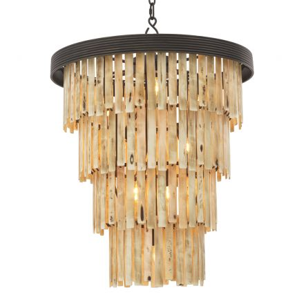 A contemporary statement chandelier with faux bone droplets and bronze accents