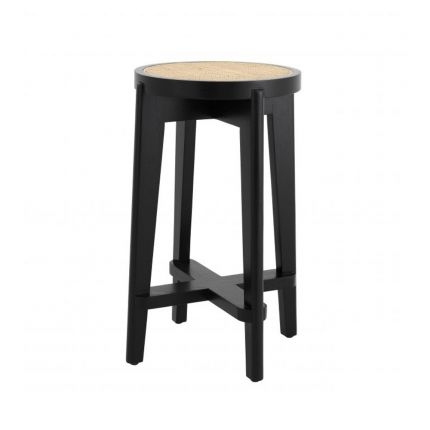 A chic Scandinavian-inspired rattan counter stool with a black finish