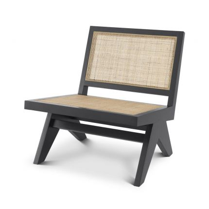 A luxurious black chair with woven rattan detailing