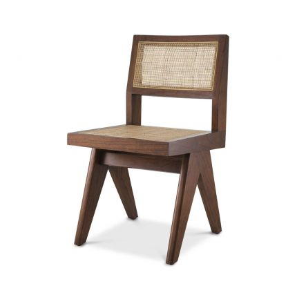 A stunning sculptural rattan dining chair in a natural brown finish