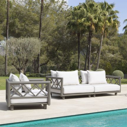 Luxury modern outdoor sofa in a greige finish with neutral linen seating by Eichholtz
