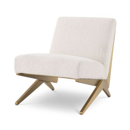 Modern Eichholtz boucle cream chair with brushed brass accents