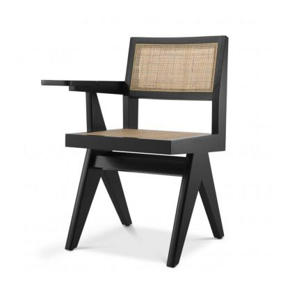 A classic Jeanerette inspired black rattan chair with a desk