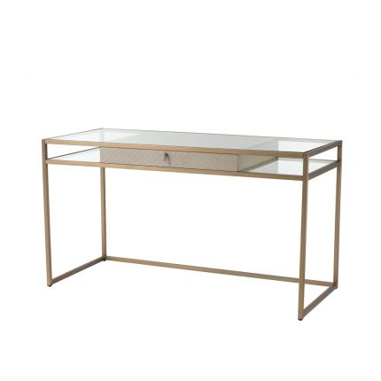 A luxurious brushed brass desk with a clear shelf and lower shelving
