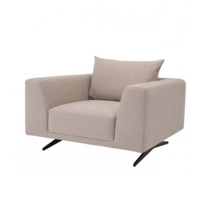 A luxurious contemporary armchair with sand-coloured upholstery and contrasting black legs