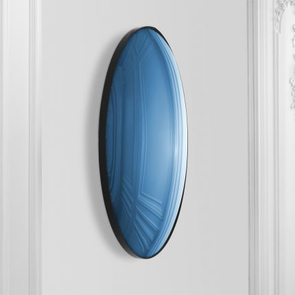 A luxurious round convex mirror with blue-tinted glass