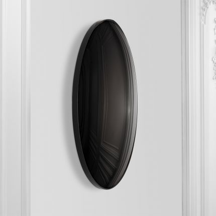 A luxurious round wall mirror with a black convex surface