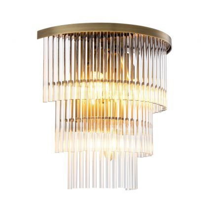 A chic clear glass and antique brass wall lamp