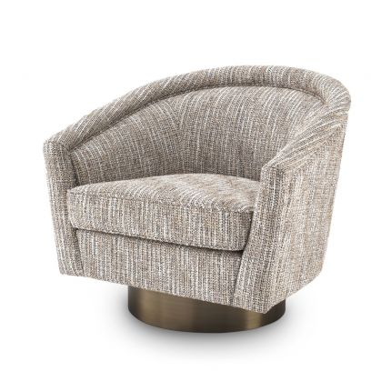 A woven beige armchair with a matte gold swivel base