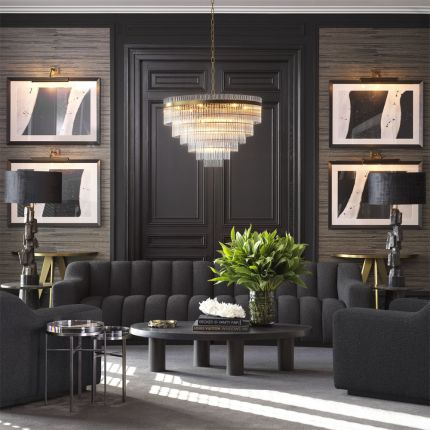 A glamorous art deco chandelier with brass accents by Eichholtz