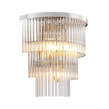 An elegant clear glass and polished nickel wall lamp