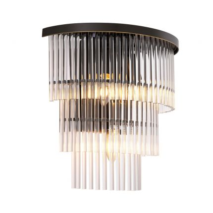 A contemporary ribbed glass and bronze metal wall lamp