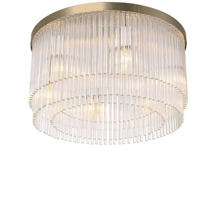 Art deco inspired ceiling lamp in a light brass finish.