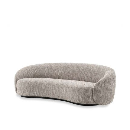 Curved sofa upholstered in a beige fabric.