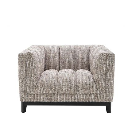 beautifully upholstered beige armchair