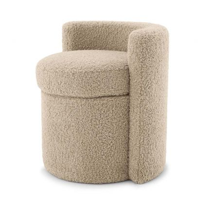 A fluffy stool upholstered in a sand coloured fabric with a curved back.