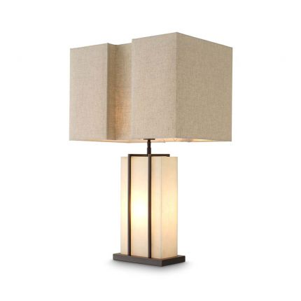 A contemporary table lamp with an alabaster base encased with a brass frame.